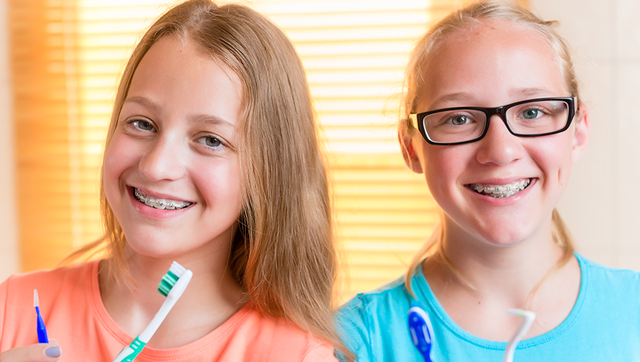 Two young patients wear braces for kids